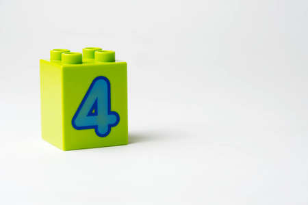 the number four written on the block from the childrens constructor