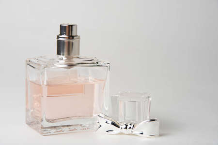 pink women's perfume bottle in a rectangular glass bottle on a white background