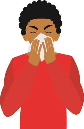 A young man sneezing and covering his nose and mouth with tissue
