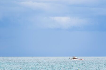 Boat on the Tyrrhenian Sea seen from the Minori and Maiori Beach, Amalfi Coast, Campania, Italy Banco de Imagens