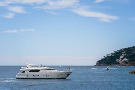Yacht in Amalfi Harbor Marina Coppola, Amalfi Port, province of Salerno, the region of Campania, Amalfi Coast, Costiera Amalfitana, Italy