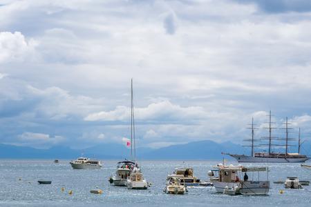 Sailing ship, yachts, fishing boats, and boats in Amalfi Harbor Marina Coppola, Amalfi Port, province of Salerno, the region of Campania, Amalfi Coast, Costiera Amalfitana, Italy