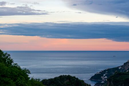 Sunset over the Tyrrhenian sea, viewed from the Terrace of Infinity or Terrazza dellInfinito, Villa Cimbrone, Ravello village, Amalfi coast of Italy Banco de Imagens
