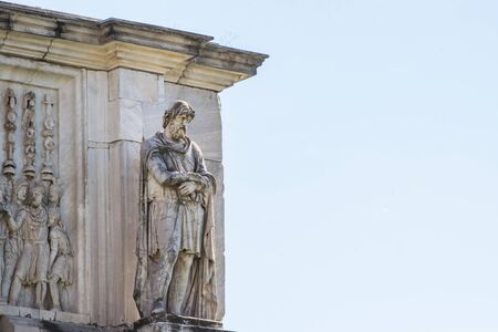 Statue on the Arch of Constantine, Roman Forum, Rome, Italy Banco de Imagens - 130818738