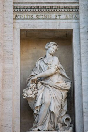 Statue representing the abundance in the Trevi Fountain or Fontana di Trevi in Rome, Italy