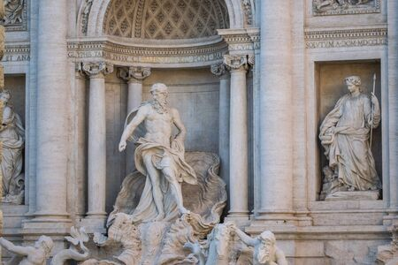 Trevi Fountain or Fontana di Trevi detail of the statue of the God of the Ocean, Rome, Italy Stock Photo