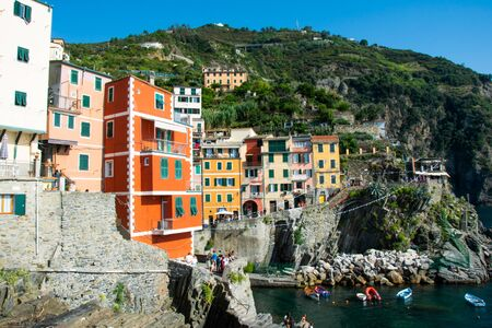 Colorful buildings in the port of Riomaggiore, Cinque Terre, La Spezia, Italy