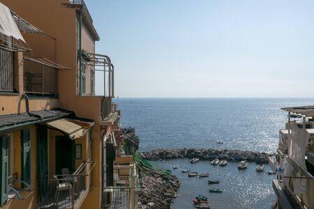 Colorful buildings in the port of Riomaggiore, Cinque Terre, La Spezia, Italy Banco de Imagens - 133427702