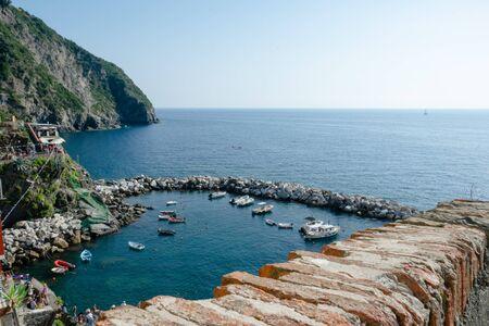 The port of Riomaggiore seen from the cliff, Cinque Terre, La Spezia, Italy Banco de Imagens - 133427703
