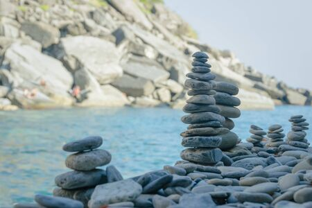 Stones towers raised close to the new beach of Vernazza, Cinque Terre, La Spezia, Italy Banco de Imagens