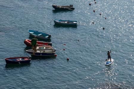 Boats, Sailing Ships, on the port of Riomaggiore, Cinque Terre, La Spezia, Italy Banco de Imagens - 133426070