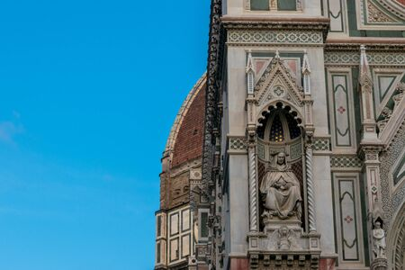 Statue on the wall of the Cathedral of Santa Maria del Fiore in Florence, Tuscany, Italy Banco de Imagens