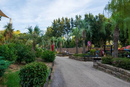 The Zoomarine park with the palm trees and benches Stock Photo - 140760055