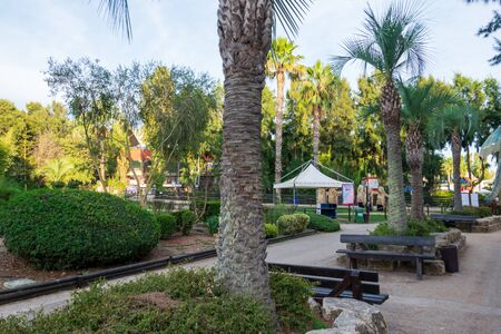 The Zoomarine park with the palm trees and benches Stock Photo - 140760056