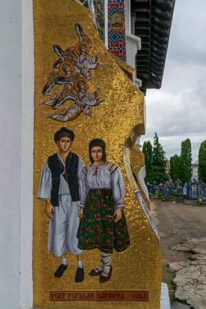 A traditional image on the external walls of the church of the birth of the Blessed Virgin Mary from Merry Cemetery, Sapanta, Romania