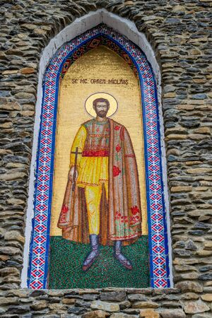 An icon on the external walls of the church of the birth of the Blessed Virgin Mary from Merry Cemetery, Sapanta, Romania Stock Photo