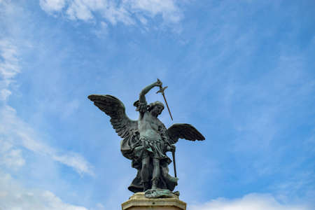 Statue of Saint Michael Archangel on the top of Sant' Angelo Castle, Mausoleum in Rome, Italy Foto de archivo
