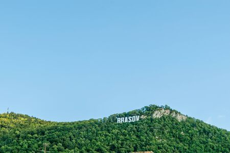 The name of Brasov in volumetric letters on the Tampa mountain from City Hall Square, Romania