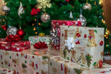 Christmas presents placed beneath the Christmas tree
