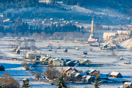 Houses covered with snow in a fantastic winter landscape from Ortoaia, Dorna Arini, Suceava County, Romania