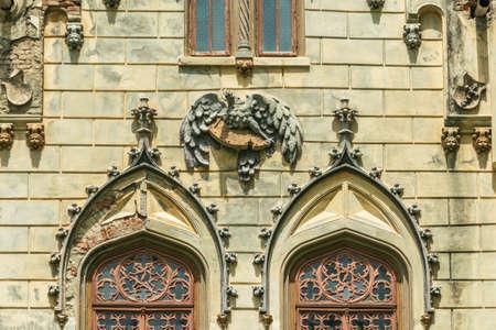 The windows above the entrance to the Sturdza castle in Miclauseni, Romania Editorial