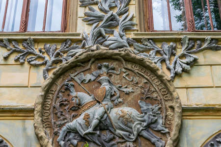 A wall sculpture illustrating a worrier who riding a horse, Sturdza castle in Miclauseni, Romania Editorial