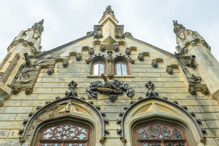 A wall sculpture above the entrance to Sturdza castle in Miclauseni, Romania