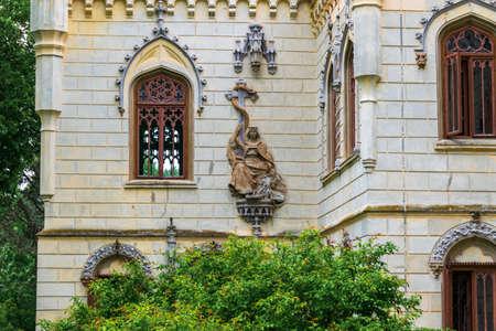Statue on the walls of the Sturdza castle in Miclauseni, Romania