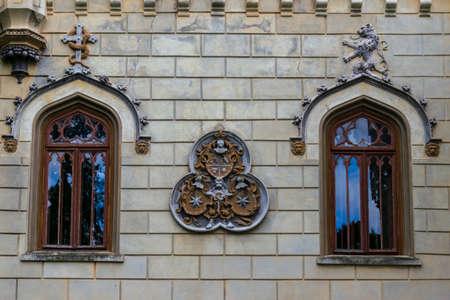 A wall sculpture illustrating shields and worrier helmet, Sturdza castle, Miclauseni, Romania