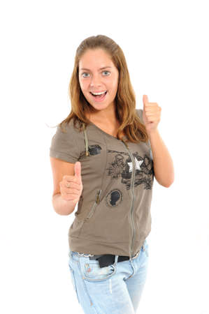 The young girl has lifted greater fingers. It in a jacket and jeans. Delight, happiness photo
