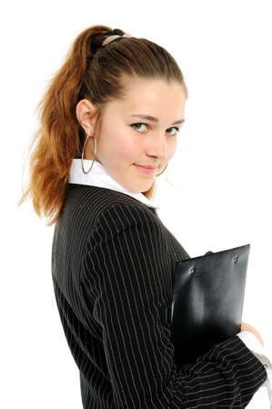 Portrait of the young business woman with a folder