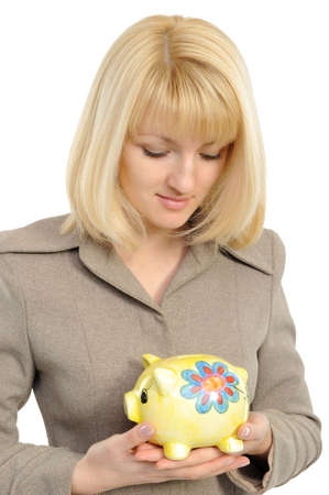 Business woman with a piggybank isolated on white photo