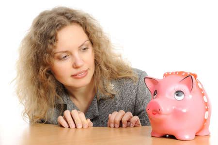 Business woman with a piggy bank  photo