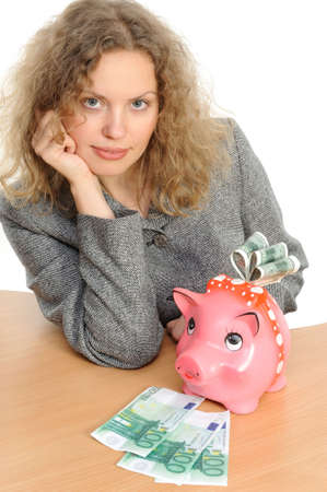 Business woman with a piggy bank Stock Photo - 6248319