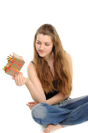 The happy woman with the gift, separately on a white background Stock Photo - 6391382