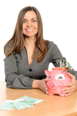Business woman with a piggy bank isolated on white Stock Photo - 6444496