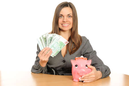 Business woman with a piggy bank isolated on white photo