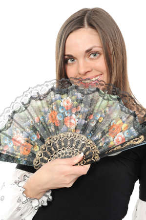 Beautiful young woman with fan isolated over white background photo
