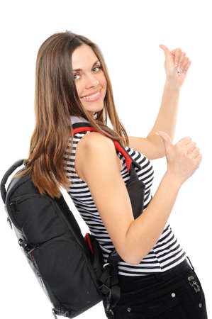 young woman with thumbs , bears a backpack, isolated on a white background photo