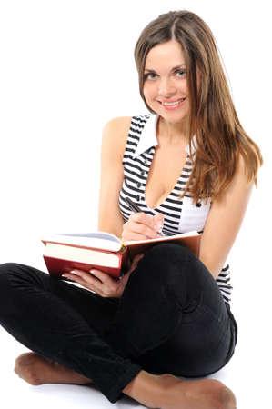 Girl doing homework on a white background photo