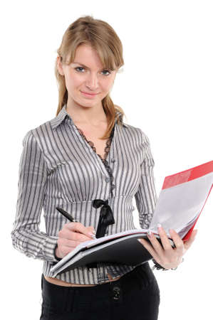 Young woman in business attire holding a plannerfolder