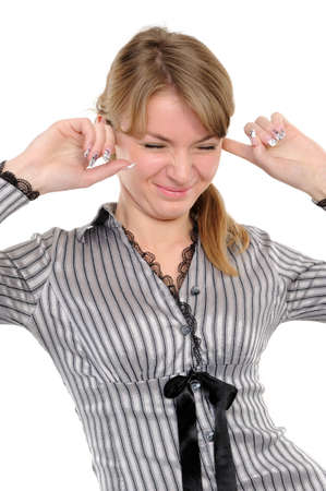 Young woman with his hands covering his ears not to hear noise. photo