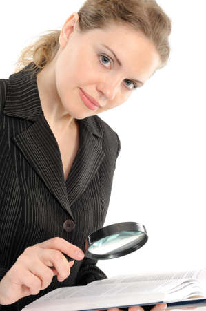 Businesswoman looking the book with magnifying glass on a white background photo