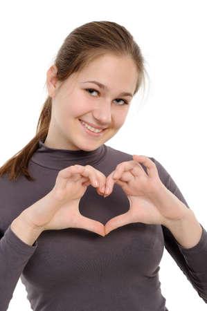 """Jong meisje weergegeven: """"hart"""" met haar vingers. Geïsoleerd op witte achtergrond"""