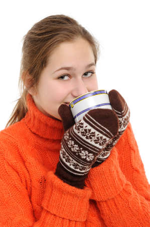 Young woman in winter  with cup of hot chocolate or coffee or tea photo