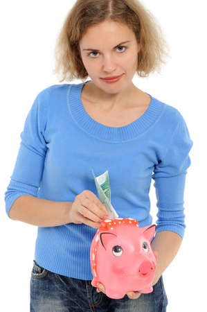 woman with a piggybank isolated on white  photo