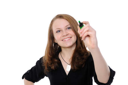 Young woman drawing something on screen with a pen - isolated over a white background  photo