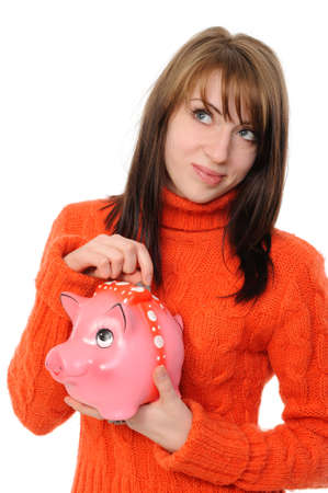 Young beautiful woman standing with piggy bank (money box), isolated on white background Stock Photo - 8668992