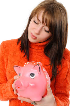Young beautiful woman standing with piggy bank (money box), isolated on white background Stock Photo - 8668995