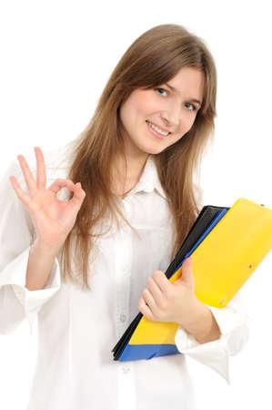 Beautiful young lady indicating ok sign, isolated on white.  photo